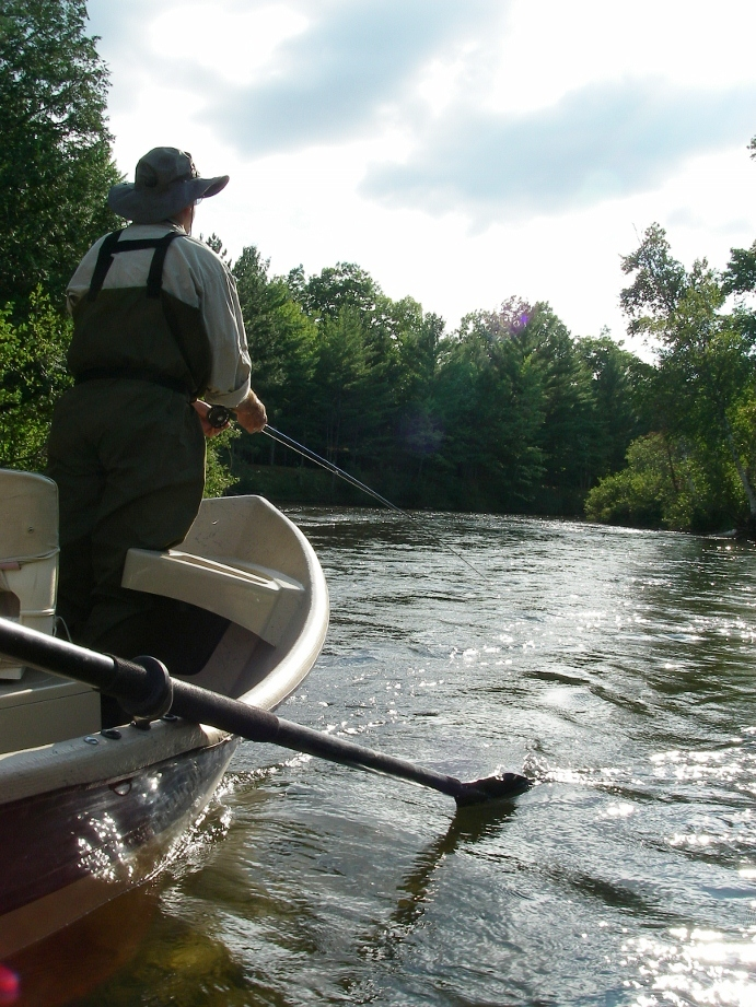 Fly fishing guide trips in traverse city northern michigan for Fly fishing vacation packages